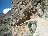 Narrow Rocky trail via cliff